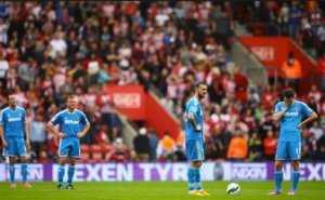 Sunderland players looking on dejected after letting past 8 without reply (Source: www.mirror.co.uk)