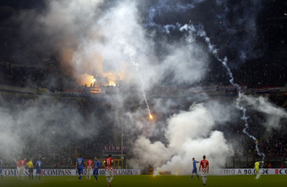 Smoke and flares envelops the atmosphere of San Siro during the Italy-Croatia match. (Source: bleacherreport.com)