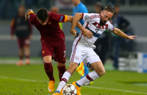 AS Roma's Juan Manuel Iturbe (#7) tangling with Bayern Munich's Franck Ribery (Right) for the ball. (Source: axs.com)