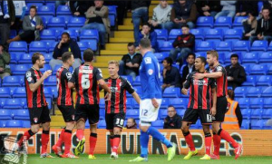 Bournemouth players celebrating with Birmingham City's Lee Novak (#12) looking on. (Source: Birmingham City's Official FB Page)
