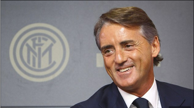 Roberto Mancini is all smiles during a press conference on his return. (Source: dailymail.co.uk)