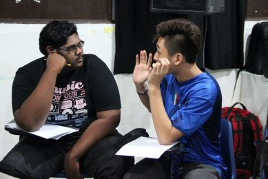 SHINE accountability buddies, Jagannath and Ka Poh, sharing a personal moment with each other. (Source: SAC)