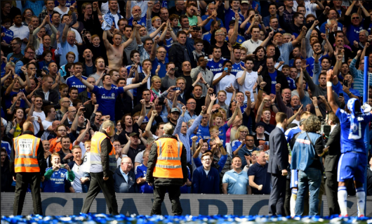 Chelsea fans celebrating their team's title league title triumph. (Source: www.mirror.co.uk)
