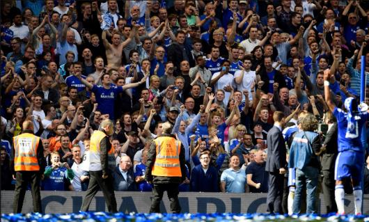 Chelsea fans celebrating their team's title league title triumph. (Source: www.mirror.co.uk)
